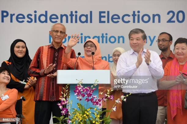 Singapore's new presidentelect Halimah Yacob addresses supporters at the nomination centre in Singapore on September 13 2017 An establishment...
