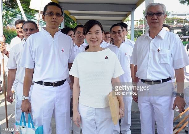 Singapore's People's Action Party member Tin Pei Ling is pictured with party members as she visits a nomination centre to file documents on...