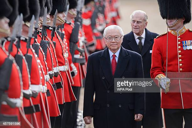 Singapore's President Tony Tan Keng Yam reviews an honour guard accompanied by Britain's Prince Philip Duke of Edinburgh during the ceremonial...