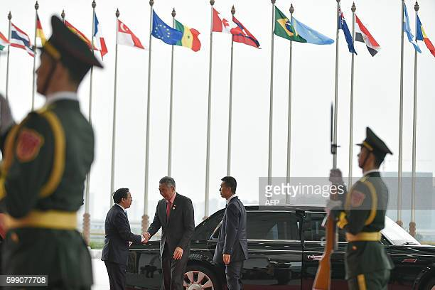 Singapore's Prime Minister Lee Hsien Loong arrives at the Hangzhou International Expo Center to attend the G20 Summit in Hangzhou on September 4,...