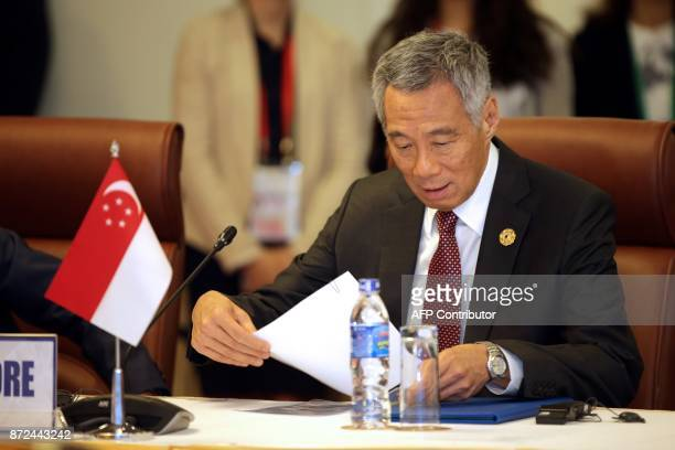 Singapore's Prime Minister Lee Hsien Loong attends the TransPacific Partnership meeting on the sidelines of the AsiaPacific Economic Cooperation...