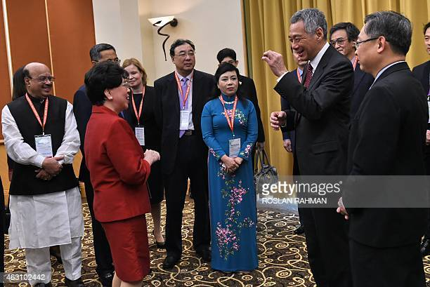 Singapore's Prime Minister Lee Hsien Loong chats with Margaret Chan directorgeneral of World Health Organisation and other heads of delegations prior...