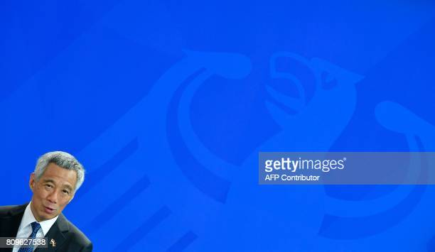 Singapore's Prime Minister Lee Hsien Loong gives a joint press conference with the German Chancellor on July 6 2017 at the Chancellery in Berlin /...