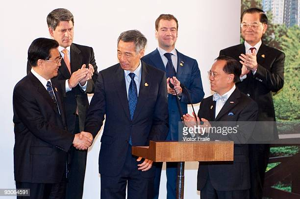 Singapore's Prime Minister Lee Hsien Loong is congratulated by China's President Hu Jintao Canada's Prime Minister Stephen Harper Russian President...