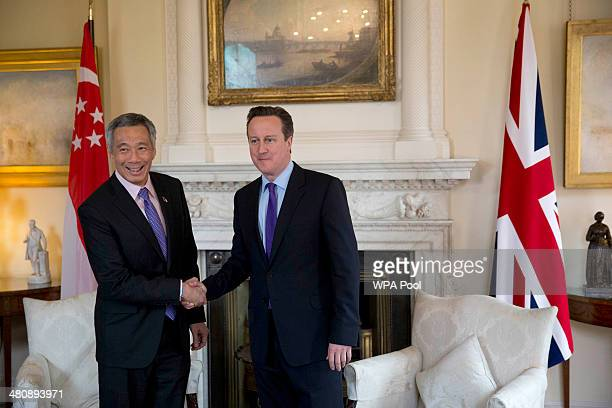 Singapore's Prime Minister Lee Hsien Loong shakes hands with British Prime Minister David Cameron before the start of their meeting inside 10 Downing...