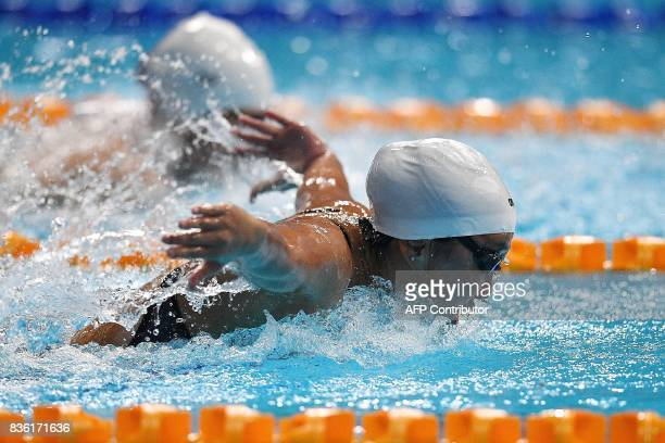 Singapore's Quah Jing Wen competes in the women's swimming 200m butterfly final of the 29th Southeast Asian Games at the National Aquatics centre in...