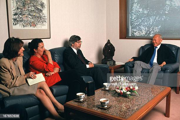 Singapore's Senior Minister Lee Kwan Yew talks with correspondents from Time Magazine in his office including Sandra Burton Joelle Attinger and James...