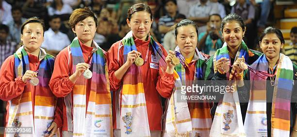 Singapore's silver medalists Wang Yungu and Feng Tianwei, Singapore's gold medalists Sun Belbei and Li Jiawei and India's bronze medalists Poulomi...