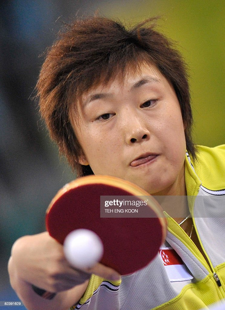Singapore's table tennis player Feng Tianwei plays against China's Wang Nan during the Women's Team table tennis final match of the 2008 Beijing Olympic Games at the Peking University gymnasium in Beijing on August 17, 2008. AFP PHOTO / TEH Eng Koon