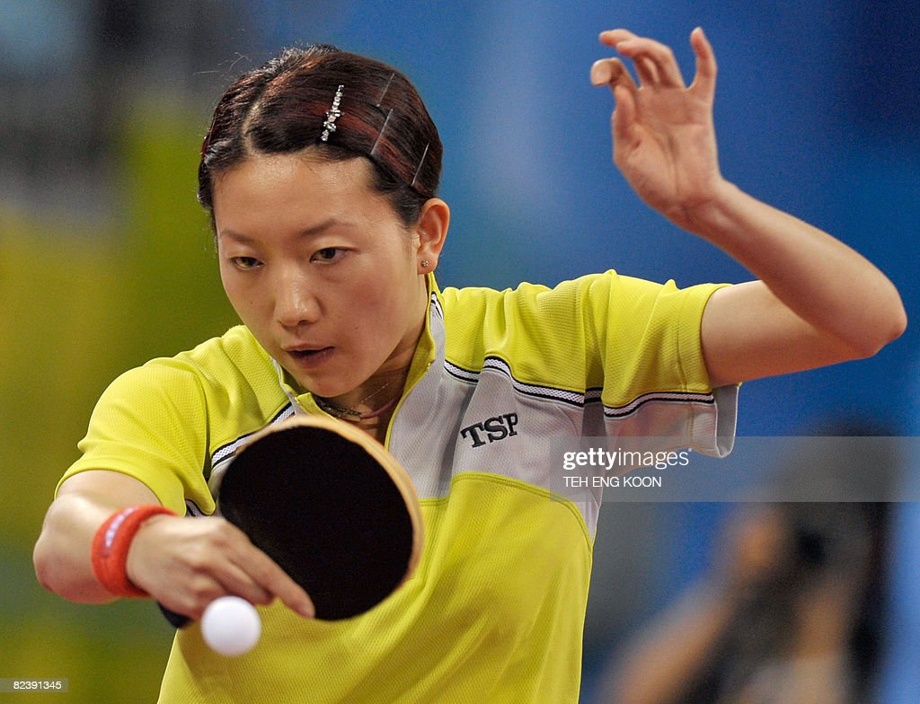 Singapore's table tennis player Li Jia Wei plays against China's Zhang Yining during the women's team table tennis final match of the 2008 Beijing Olympic Games at the Peking University gymnasium in Beijing on August 17, 2008. AFP PHOTO / TEH Eng Koon