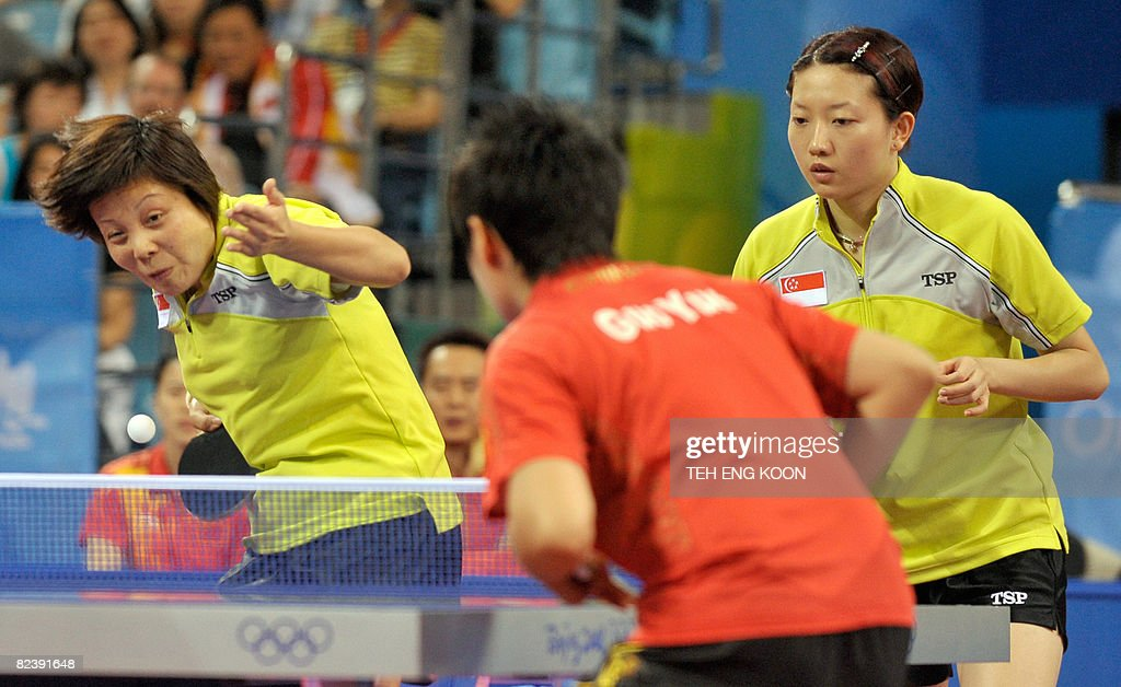 Singapore's table tennis player Wang Yue Gu (L) and Li Jiawei (R) play against China's Zhang Yining and Guo Yue during the Women's Team table tennis final match of the 2008 Beijing Olympic Games at the Peking University gymnasium in Beijing on August 17, 2008. China won gold, Singapour took silver and South Korea claimed bronze. AFP PHOTO / TEH Eng Koon