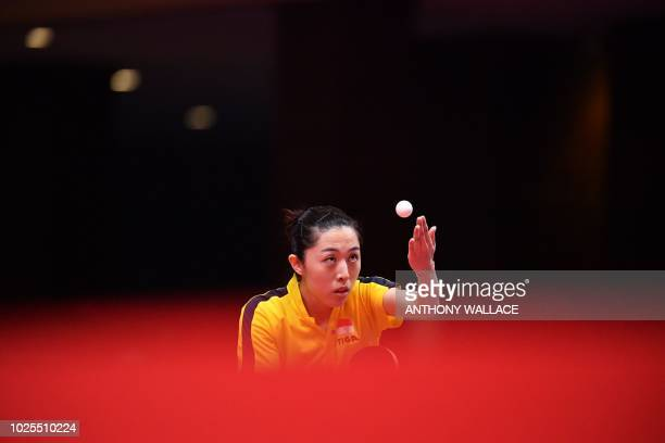Singapore's Yu Mengyu serves to Taiwan's Cheng Iching during their women's quarterfinal table tennis match at the Asian Games in Jakarta on August 31...