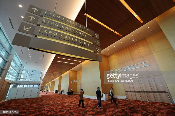 STORY Singaporetourismeconomyconvention by M Rochan People walk the hall way of Sands Expo and Convention Centre at the Marina Bay Sands in Singapore...