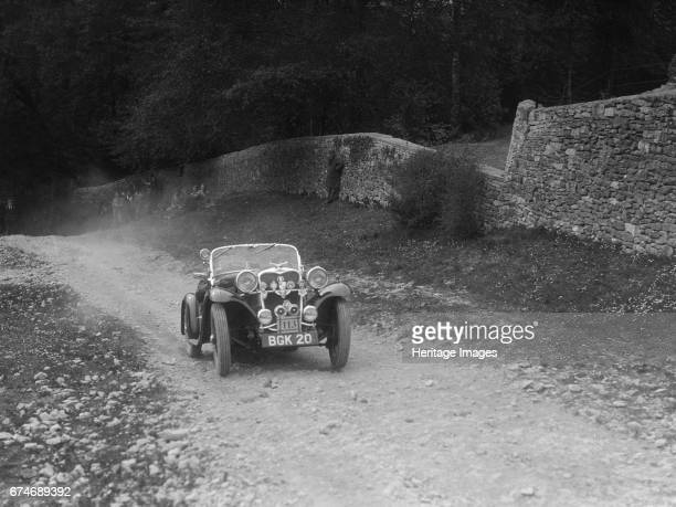 Singer 2seater sports competing in a motoring trial Nailsworth Ladder Gloucestershire 1930s Artist Bill Brunell