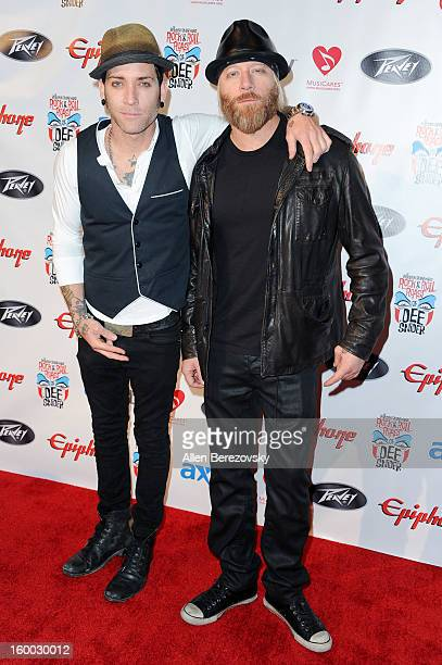 Singer A Jay Popoff and guitarist Jeremy Popoff of Lit arrive at the Revolver/Guitar World Rock Roll roast of Dee Snider at City National Grove of...