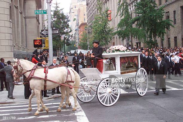 RB singer Aaliyah's funeral procession arrives at St Ignatius Loyola Roman Catholic Church in New York City 8/31/2001 Photo Evan Agostini/Getty Images