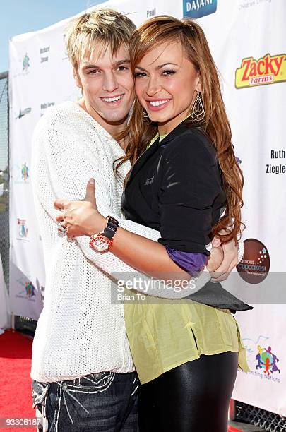 Singer Aaron Carter and dancer Karina Smirnoff attend Children Uniting Nations' 11th Annual Day of The Child at Barkar Hangar on November 22 2009 in...