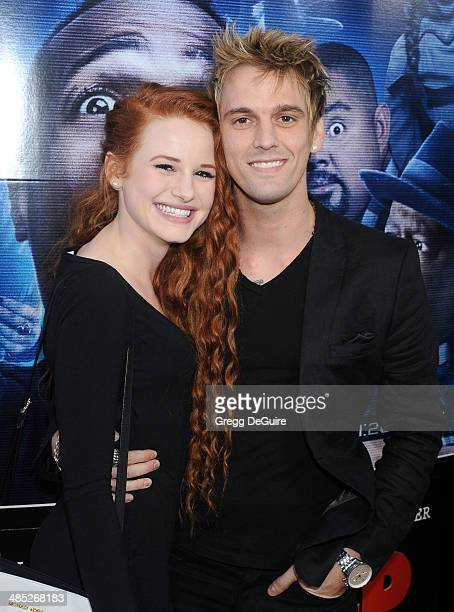 Singer Aaron Carter and guest arrive at the Los Angeles premiere of 'A Haunted House 2' at Regal Cinemas LA Live on April 16 2014 in Los Angeles...