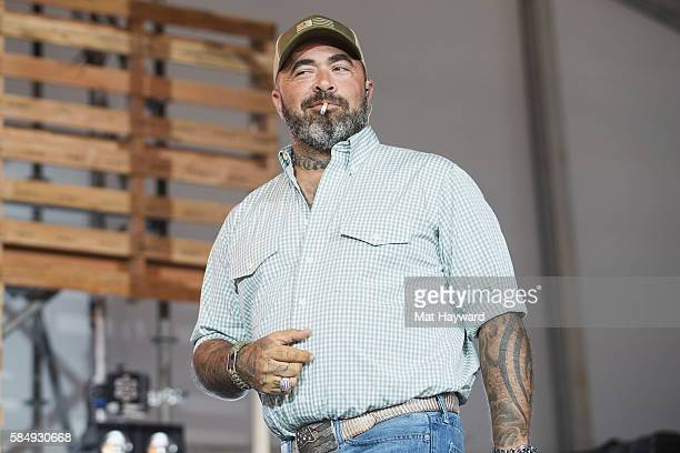 Singer Aaron Lewis smokes a cigarrett while performing on the Next From Nashville stage during the Watershed Music Festival at Gorge Amphitheatre on...