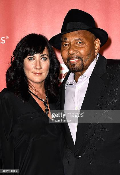Singer Aaron Neville and photographer Sarah A Friedman attend the 25th anniversary MusiCares 2015 Person Of The Year Gala honoring Bob Dylan at the...