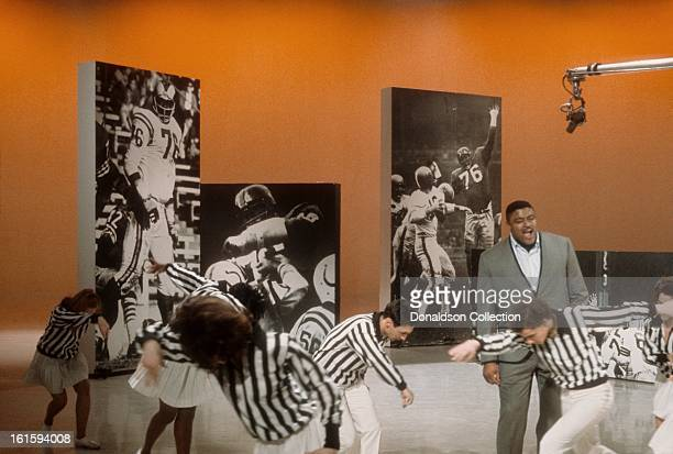 Singer actor and NFL star Rosey Grier performs on the NBC TV music show 'Hullabaloo' in March 1965 in New York City New York
