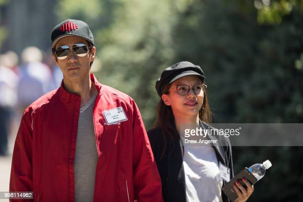 Singer actor and producer Wang Leehom walks with his wife Lee Jinglei during the annual Allen Company Sun Valley Conference July 13 2018 in Sun...