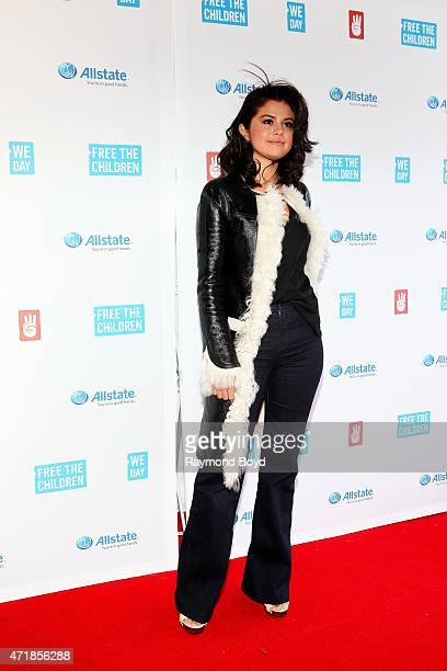 Singer actress and cohost of We Day Selena Gomez poses for photos on the red carpet during 'We Day' at the Allstate Arena on April 30 2015 in...