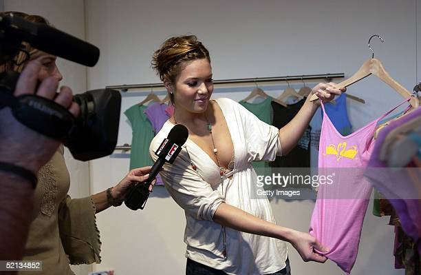 Singer / actress Mandy Moore shows off one of her designs at the Summer 2005 Launch of Mblem by Mandy Moore on February 3 2005 at a New Mart showroom...