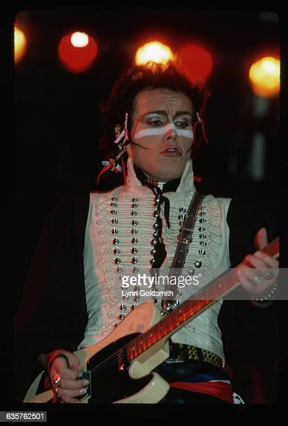 Singer Adam Ant plays guitar wearing full makeup and a pirate costume