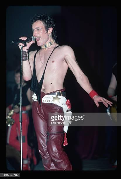 Singer Adam Ant sings shirtless in concert