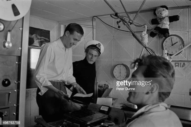 Singer Adam Faith with DJ Simon Dee and Captain McKay in a studio at the pirate radio station Radio Caroline on board the ship MV Caroline June 8th...