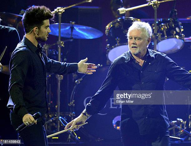 Singer Adam Lambert and drummer Roger Taylor of Queen perform during the iHeartRadio Music Festival at the MGM Grand Garden Arena on September 20...