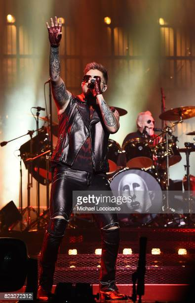 Singer Adam Lambert and drummer Roger Taylor perform with Queen at Prudential Center on July 26 2017 in Newark New Jersey