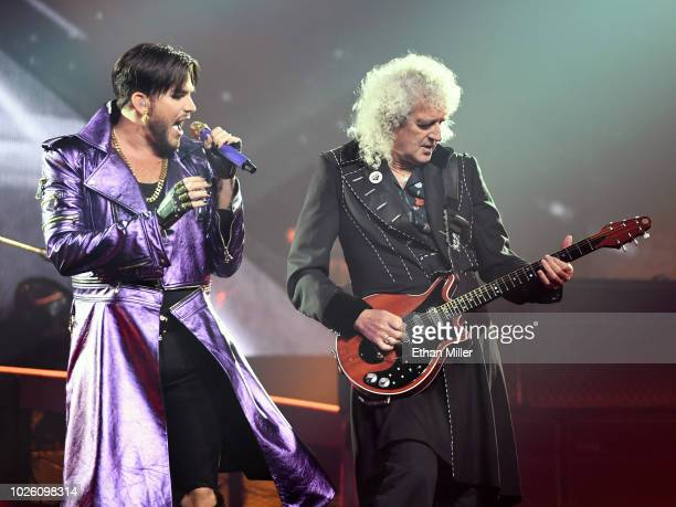Singer Adam Lambert and guitarist Brian May of Queen Adam Lambert perform as the group kicks off its 10date limited engagement The Crown Jewels at...
