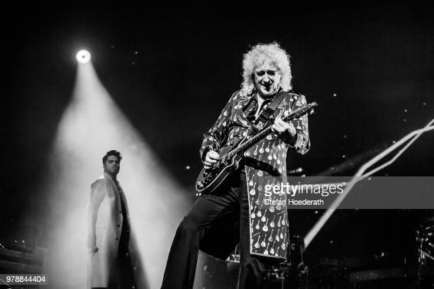 Singer Adam Lambert and guitarist Brian May of Queen perform live on stage during a concert at MercedesBenz Arena on June 19 2018 in Berlin Germany