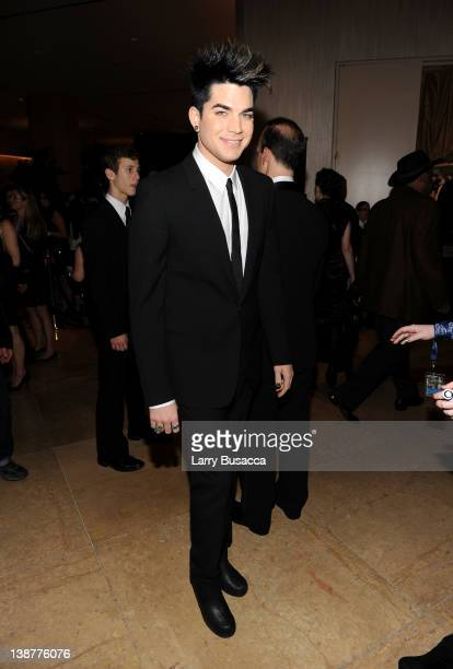 Singer Adam Lambert arrives at Clive Davis and the Recording Academy's 2012 PreGRAMMY Gala and Salute to Industry Icons Honoring Richard Branson held...
