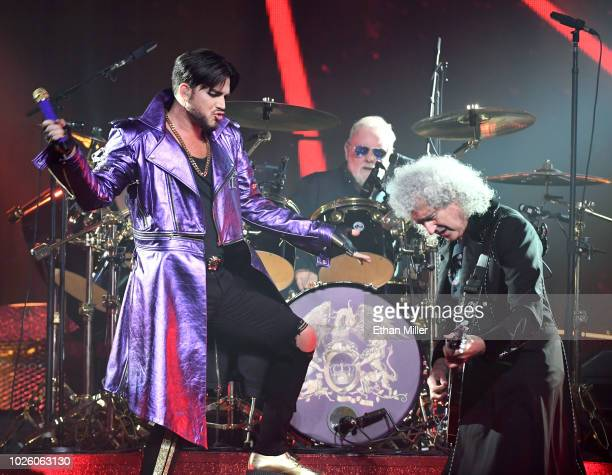 Singer Adam Lambert drummer Roger Taylor and guitarist Brian May of Queen Adam Lambert perform as the group kicks off its 10date limited engagement...