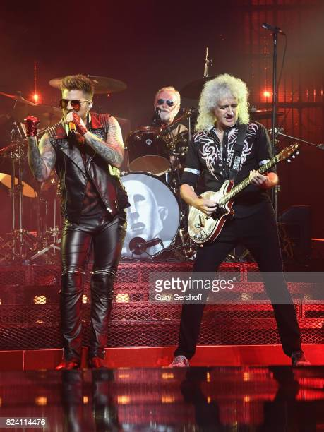 Singer Adam Lambert drummer Roger Taylor and guitarist Brian May of Queen perform on stage at Barclays Center of Brooklyn on July 28 2017 in the...