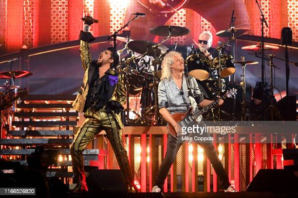 Singer Adam Lambert, guitarist Brian May, and drummer Roger Taylor of Queen + Adam Lambert perform at Madison Square Garden on August 06, 2019 in New...