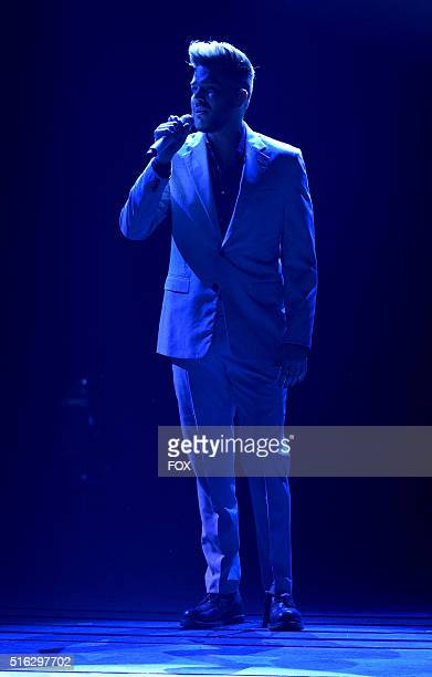Singer Adam Lambert performs onstage at FOX's American Idol Season 15 on March 17 2016 in Hollywood California