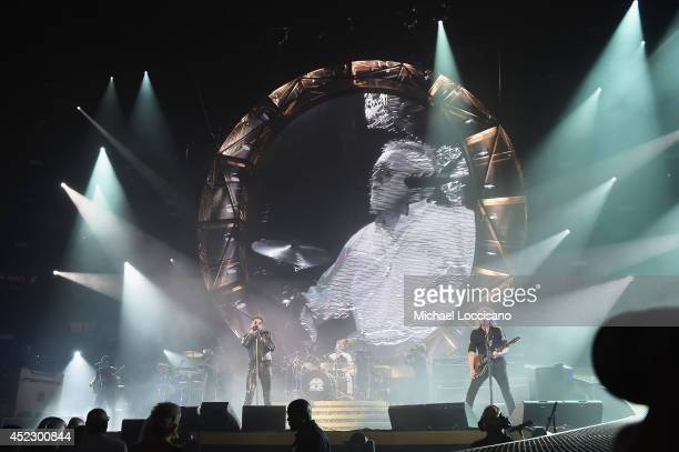 Singer Adam Lambert performs with drummer Roger Meddows Taylor and guitarist Brian May of Queen at Madison Square Garden on July 17 2014 in New York...