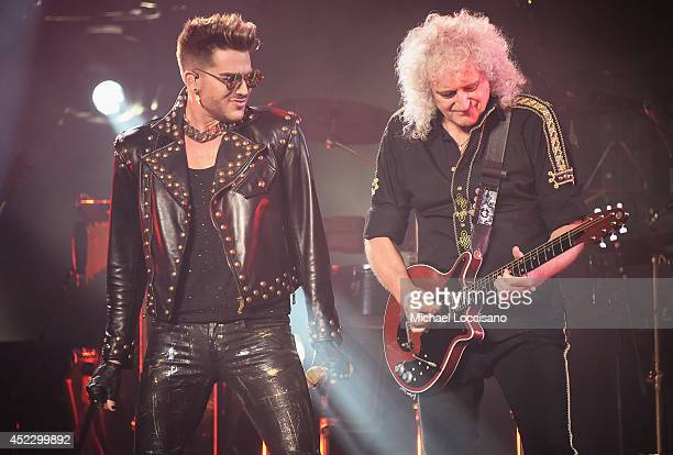 Singer Adam Lambert performs with guitarist Brian May of Queen at Madison Square Garden on July 17 2014 in New York City