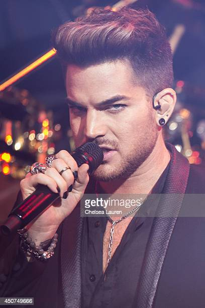 Singer Adam Lambert performs with Queen at iHeartRadio Theater on June 16, 2014 in Burbank, California.