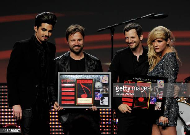 Singer Adam Lambert Songwriters of the Year Max Martin and Lukasz Dr Luke Gottwald and singer Ke$ha pose onstage at the 28th Annual ASCAP Pop Music...