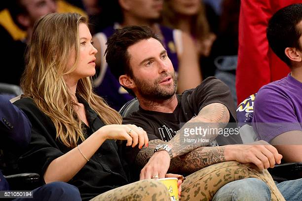 Singer Adam Levine and Behati Prinsloo are seen courtside at Staples Center on April 13 2016 in Los Angeles California NOTE TO USER User expressly...