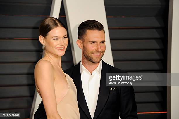 Singer Adam Levine and Behati Prinsloo attend the 2015 Vanity Fair Oscar Party hosted by Graydon Carter at Wallis Annenberg Center for the Performing...