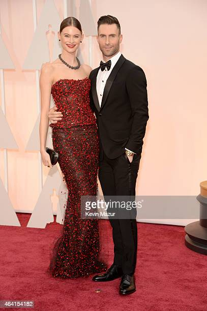 Singer Adam Levine and Behati Prinsloo attend the 87th Annual Academy Awards at Hollywood Highland Center on February 22 2015 in Hollywood California