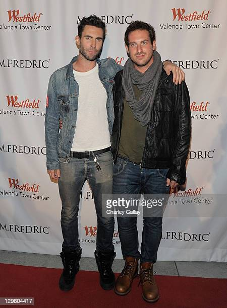 Singer Adam Levine and brother Michael Levine attend the grand opening of M. Fredric at Westfield Valencia Town Center on October 18, 2011 in...