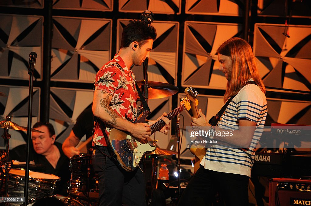 Singer Adam Levine and guitarist James Valentine of Maroon 5 perform at the #AmexEveryDayLive concert, live streamed from The Bowery Ballroom on June 20, 2014 in New York City.