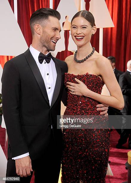 Singer Adam Levine and model Behati Prinsloo arrive at the 87th Annual Academy Awards at Hollywood Highland Center on February 22 2015 in Hollywood...